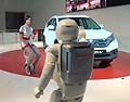 ASIMO and the personal mobility device the U3-X on stage together in Europe for the first time