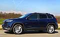 Jeep Cherokee Limited MY 2014 su strada vista laterale