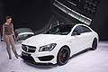 Mercedes-Benz CLA 45 AMG and model at the New York Auto Show 2013