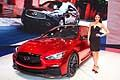 Infiniti Q50 Eau Rouge and hostess at Nord American International Auto Show of Detroit 2014