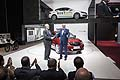 Qoros at the 2014 Geneva Motor Show: Vice Chairman Volker Steinwascher and Executive Director of design Gert Hildebrand celebrate the global debut of the Qoros 3 Hatch