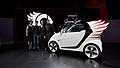 Dr Annette Winkler, Head of smart, Hubert Lee, Head of the Mercedes Advanced Design Studio in Carlsbad, fashion designer Jeremy Scott and Gorden Wagener, Head of Mercedes Cars and smart Design, with the Smart ForJeremy in Los Angeles