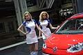 Hostess che affiancano la Volkswagen Cross Up! al Motor Show di Bologna 2011