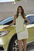 Beautiful hostess near Suzuki S-Cross at the Mondial de l´Automobile in Paris 2012